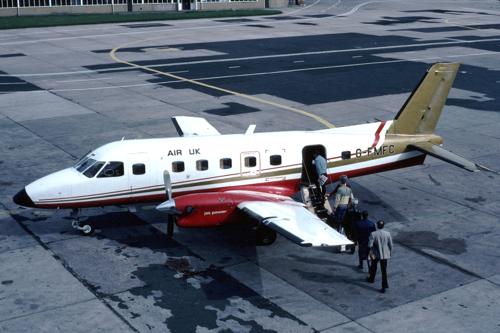 G FMFC EMB-110 P2 Bandeirante. Manchester April 1983 Originally delivered to Fairflight Charters February 1978, operated by Air Ecosse until 1984 it was leased in 1983 to Air UK. Sold in America as N890AC Midcontinent Airlines 1984, then to Islena Airlines Honduras as HR IAB September 1990. Photo Clive Grant.