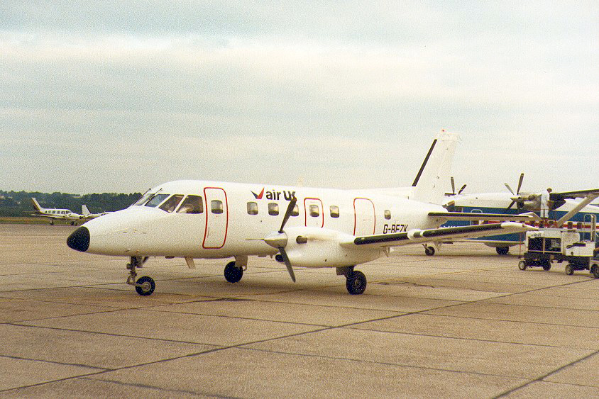 G BFZK Embraer EMB 110P2 Bandeirante. Southampton 1983 Shown in this hybrid colour scheme a chartered aircraft from Fairflight Charter. Photo by Ian Haskell.